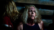 """Michael Myers is back once again for this sequel, which picks up immediately after the events of the 2018 franchise reboot. Jamie Lee Curtis is still Laurie Strode and she's still trying to take down the serial killer who terrorised her as a teenager in the 1970s. It's due to form a trilogy with the defiantly titled <a href=""""https://uk.movies.yahoo.com/halloween-ends-closure-laurie-michael-myers-131745420.html"""" data-ylk=""""slk:Halloween Ends;outcm:mb_qualified_link;_E:mb_qualified_link;ct:story;"""" class=""""link rapid-noclick-resp yahoo-link""""><em>Halloween Ends</em></a>, which awaits in 2022. (Credit: Universal)"""