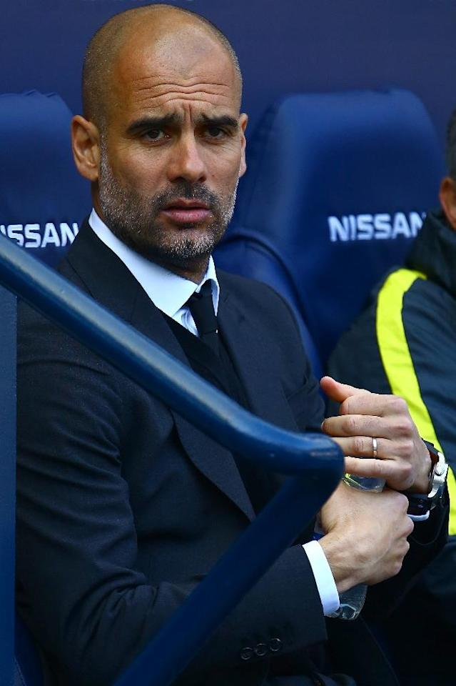 Manchester City's Pep Guardiola reacts ahead of their match against Hull City at the Etihad Stadium in Manchester, north west England, on April 8, 2017 (AFP Photo/GEOFF CADDICK)