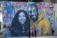 <strong>Kobe Bryant, daughter killed in chopper crash:</strong> People stop to take pictures in front of the new mural by a French artist picturing Kobe Bryant and his daughter Gigi in Los Angeles. The 41-year-old American basketball star and his 13-year-old daughter Gianna were killed, along with seven others, when their helicopter crashed into a fog-covered hillside near Calabasas, California.