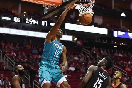 Dec 13, 2017; Houston, TX, USA; Charlotte Hornets center Dwight Howard (12) dunks as Houston Rockets guard James Harden (13), center Clint Capela (15), and guard Chris Paul (3) look on during the fourth quarter at Toyota Center. Shanna Lockwood-USA TODAY Sports
