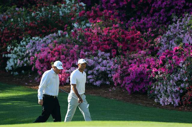 U.S. golfers Phil Mickelson (L) and Tiger Woods walk up the 13th fairway during the second day of practice for the 2018 Masters golf tournament at Augusta National Golf Club in Augusta, Georgia, U.S. April 3, 2018. REUTERS/Lucy Nicholson