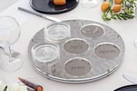 """<p>From the duo behind Studio Armadillo, Anat Stein and Hadas Kruk, this Seder plate befits any modern table. Acrylic, glass, and brass come together to create a stunning piece of servingware; the bowls are made of glass while the plate is acrylic.</p> <p><em><strong>Shop Now: </strong>Studio Armadillo</em> <em>Geometric</em> <em>Seder Plate, $233, <a href=""""https://www.awin1.com/cread.php?awinmid=6220&awinaffid=272513&clickref=MSL10PassoverSederPlatesGuaranteedtoBecomeYourNextFamilyHeirloomachurchiPasGal8067612202103I&p=https%3A%2F%2Fwww.etsy.com%2Flisting%2F686834893%2Fpassover-gift-minimalist-seder-plate"""" rel=""""sponsored noopener"""" target=""""_blank"""" data-ylk=""""slk:studioarmadillo.etsy.com"""" class=""""link rapid-noclick-resp"""">studioarmadillo.etsy.com</a>.</em></p>"""