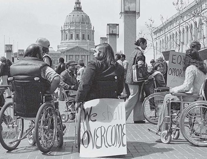"""<span class=""""caption"""">Protesters in San Francisco in 1977 express their opposition to the lack of implementation of Section 504 of the Rehabilitation Act.</span> <span class=""""attribution""""><span class=""""source"""">Anthony Tusler</span></span>"""