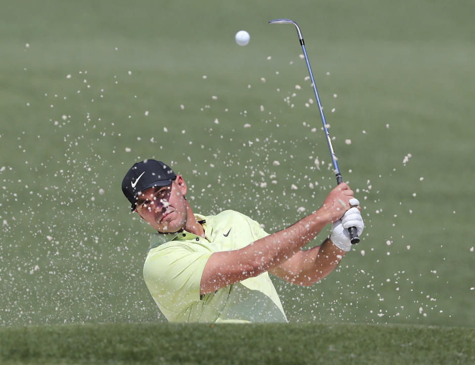 Brooks Koepka hits his bunker shot to the second green during his practice round for the Masters at Augusta National Golf Club on Tuesday, April 6, 2021, in Augusta, Ga. (Curtis Compton/Atlanta Journal-Constitution via AP)