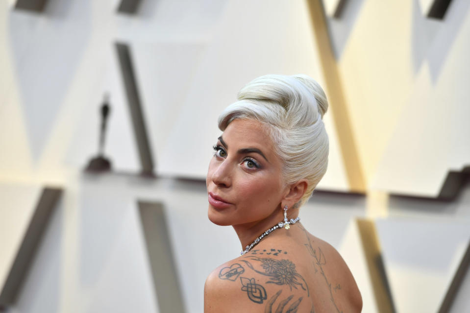 FILE - In this Feb. 24, 2019 file photo, Lady Gaga arrives at the Oscars at the Dolby Theatre in Los Angeles. Billionaire investor William Ackman is setting his sights on the music industry, as his blank check company confirms it is in talks to buy a 10% stake of Universal Music Group for about $4 billion. French media company Vivendi, which owns Universal Music, also confirmed the discussions on Friday, June 4, 2021. (Photo by Jordan Strauss/Invision/AP, File)