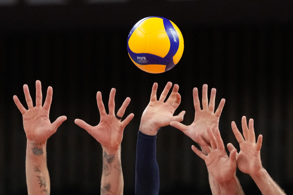 United States's players reach up to block a return ball during a men's volleyball preliminary round pool B match against France, at the 2020 Summer Olympics, Saturday, July 24, 2021, in Tokyo, Japan. (AP Photo/Frank Augstein)