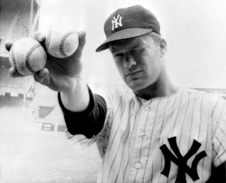 """FILE - In this Oct. 14, 1964 file photo, New York Yankees pitcher Jim Bouton takes aim as he holds two balls in the right hand that his teammates hope will lead them to victory in the sixth World Series game in New York. Jim Bouton, the New York Yankees pitcher who shocked the conservative baseball world with the tell-all book """"Ball Four,"""" has died, Wednesday, July 10, 2019. He was 80.(AP Photo/File)"""