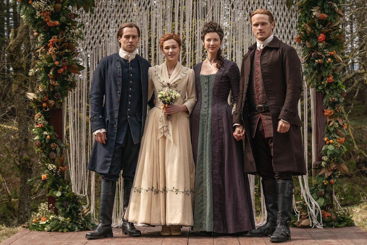 """<p>The Droughtlander is almost over, everyone—<a href=""""https://www.townandcountrymag.com/leisure/arts-and-culture/a20648462/outlander-season-5/"""" target=""""_blank"""">season five of </a><em><a href=""""https://www.townandcountrymag.com/leisure/arts-and-culture/a20648462/outlander-season-5/"""" target=""""_blank"""">Outlander</a> </em>will debut on Starz this coming Sunday, February 16. To whet your appetite for all the romantic drama to come, Starz has released a few stunning photos from one of the new season's most anticipated scenes: Brianna's (Sophie Skelton) marriage to Roger (Richard Rankin), which is attended by both of her parents thanks to the magic of time travel. </p>"""