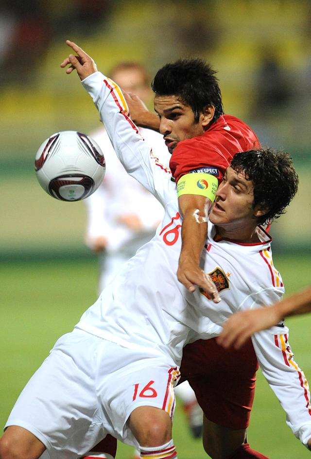 Jose Gomez (L) of Spain vies for the ball with Orhan Gulle (R) of Turkey during football final tournament of UEFA European Under-19 Championship 2010/2011 in Chiajna village next to Bucharest July 26, 2011. AFP PHOTO/DANIEL MIHAILESCU (Photo credit should read DANIEL MIHAILESCU/AFP/Getty Images)
