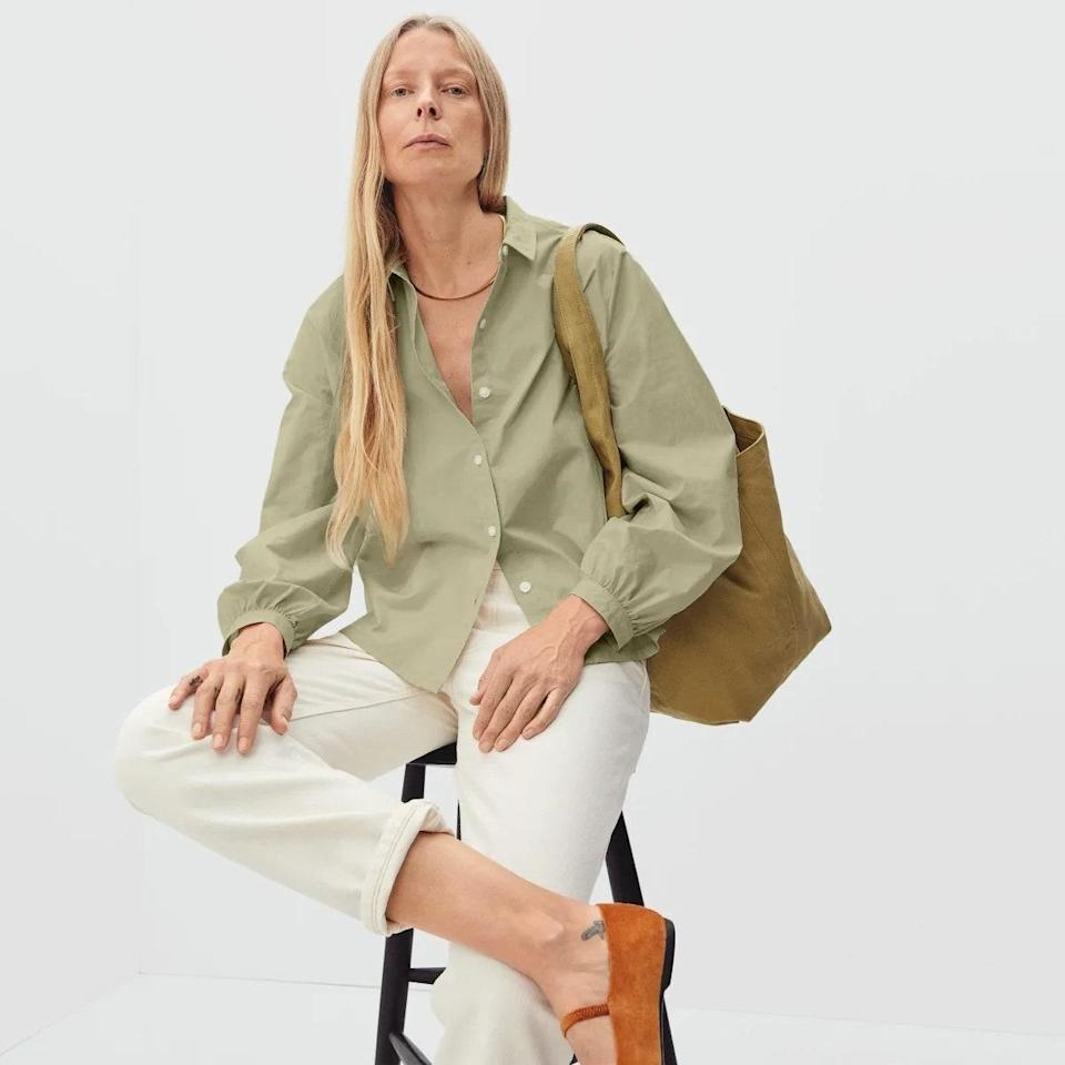 """With a return to office top of mind for most, this khaki Everlane top is both practical and chic—and neutral enough to wear two days in a row without anyone noticing. $75, Everlane. <a href=""""https://www.everlane.com/products/womens-prep-shirt-sage?collection=womens-tops"""" rel=""""nofollow noopener"""" target=""""_blank"""" data-ylk=""""slk:Get it now!"""" class=""""link rapid-noclick-resp"""">Get it now!</a>"""