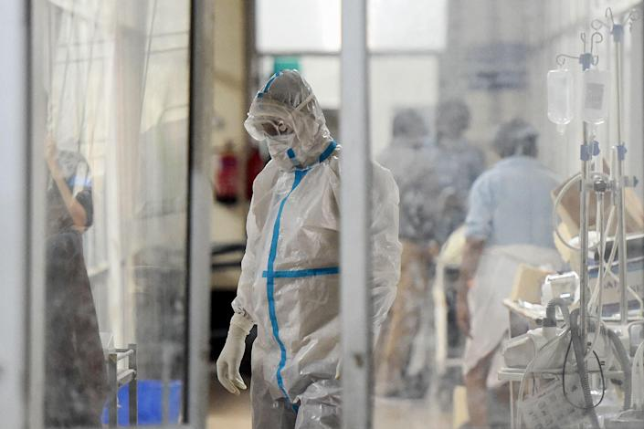 Health worker attending a Covid-19 patient in India (AFP via Getty Images)