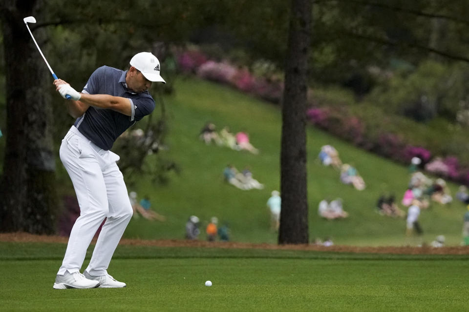 Sergio Garcia, of Spain, hits from the fairway on the 15th hole during the second round of the Masters golf tournament on Friday, April 9, 2021, in Augusta, Ga. (AP Photo/Charlie Riedel)