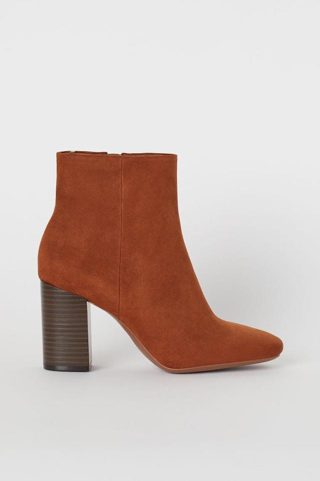 """<p>Wear these <a href=""""https://www.popsugar.com/buy/HampM-Block-heeled-Ankle-Boots-494979?p_name=H%26amp%3BM%20Block-heeled%20Ankle%20Boots&retailer=www2.hm.com&pid=494979&price=40&evar1=fab%3Aus&evar9=46084750&evar98=https%3A%2F%2Fwww.popsugar.com%2Fphoto-gallery%2F46084750%2Fimage%2F46684663%2FHM-Block-heeled-Ankle-Boots&list1=fall%20fashion%2Cshoes%2Cfall%2Cspring%2Csummer%2Cshoppping%2Cspring%20fashion%2Csummer%20fashion%2Caffordable%20shopping&prop13=api&pdata=1"""" rel=""""nofollow"""" data-shoppable-link=""""1"""" target=""""_blank"""" class=""""ga-track"""" data-ga-category=""""Related"""" data-ga-label=""""https://www2.hm.com/en_us/productpage.0632523005.html"""" data-ga-action=""""In-Line Links"""">H&amp;M Block-heeled Ankle Boots</a> ($40) with your favorite jeans.</p>"""