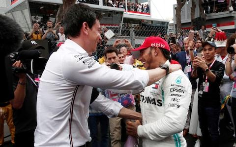 Lewis Hamilton is congratulated on his victory by Mercedes team principal Toto Wolff - Credit: Reuters