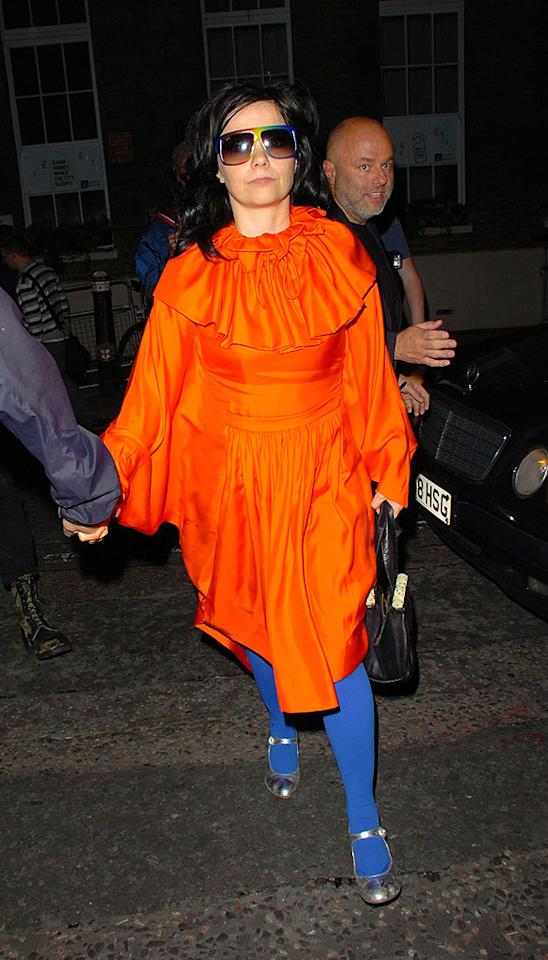 "We love that Bjork is a fashion trailblazer, but she looks like a clown in this blazing poncho-style dress, bright blue tights, and rainbow sunglasses. William Richards/<a href=""http://www.filmmagic.com/"" target=""new"">FilmMagic.com</a> - June 18, 2007"