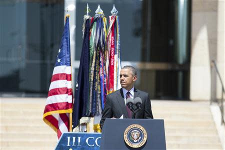 U.S. President Barack Obama addresses the crowd during a memorial service for the victims of the April 2 shooting incident at the base at Fort Hood, Texas