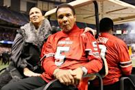 <p>NEW ORLEANS, LA – JANUARY 02: Boxing legend Muhammad Ali and his wife Lonnie Ali ride a golf cart onto the field to represent the Louisville Cardinals for the coin toss against the Florida Gators prior to the start of the Allstate Sugar Bowl at Mercedes-Benz Superdome on January 2, 2013 in New Orleans, Louisiana. (Photo by Kevin C. Cox/Getty Images)</p>