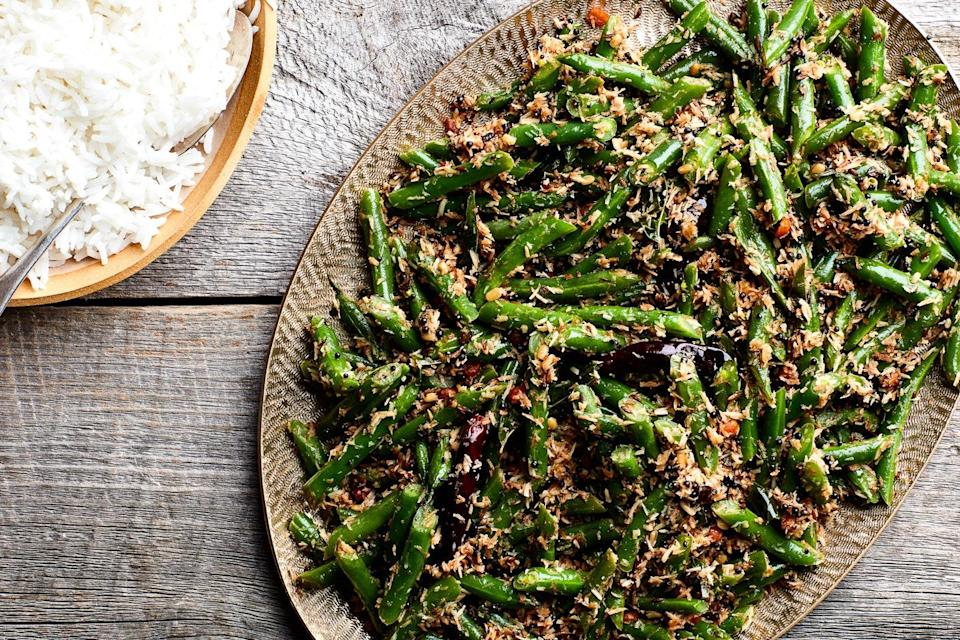 "This preparation from chef Suvir Saran pairs green beans with unsweetened coconut, cumin, curry leaves, fresh chiles, and a few other spices, and would make a terrific accompaniment to a meal of lentils and rice. <a href=""https://www.epicurious.com/recipes/food/views/stir-fried-green-beans-with-coconut?mbid=synd_yahoo_rss"" rel=""nofollow noopener"" target=""_blank"" data-ylk=""slk:See recipe."" class=""link rapid-noclick-resp"">See recipe.</a>"