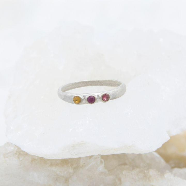 "<p><strong>Lisa Leonard Designs</strong></p><p>lisaleonard.com</p><p><strong>$79.99</strong></p><p><a href=""https://www.lisaleonard.com/mothers-rings-sterling-silver-prd-llr0037-si/"" rel=""nofollow noopener"" target=""_blank"" data-ylk=""slk:Shop Now"" class=""link rapid-noclick-resp"">Shop Now</a></p><p>This ring features each child's or grandchild's birthstone in its own sterling silver bezel set. You can choose sterling silver, 10k gold or 14k gold — or, if the three-in-a-row designs don't appeal, you can also go for a <a href=""https://www.lisaleonard.com/finespun-birthstone-ring-sterling-silver-prd-llr0027-si/"" rel=""nofollow noopener"" target=""_blank"" data-ylk=""slk:stacking set"" class=""link rapid-noclick-resp"">stacking set</a>. </p>"