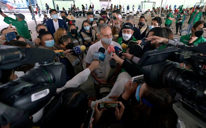 Mexico's undersecretary of health, Hugo Lopez-Gatell, speaks after receiving his first dose of the Pfizer-BioNTech vaccine against COVID-19 at a vaccination center May 13 in Mexico City.