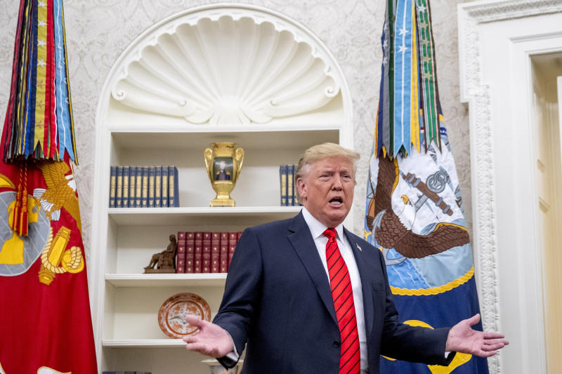 President Donald Trump speaks to member of the media as he departs a ceremonial swearing in ceremony for new Labor Secretary Eugene Scalia in the Oval Office of the White House in Washington, Monday, Sept. 30, 2019. (AP Photo/Andrew Harnik)