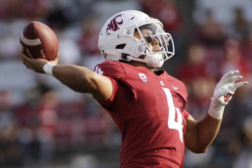 Washington State quarterback Jayden de Laura throws a pass during the second half of an NCAA college football game against Portland State, Saturday, Sept. 11, 2021, in Pullman, Wash. (AP Photo/Young Kwak)