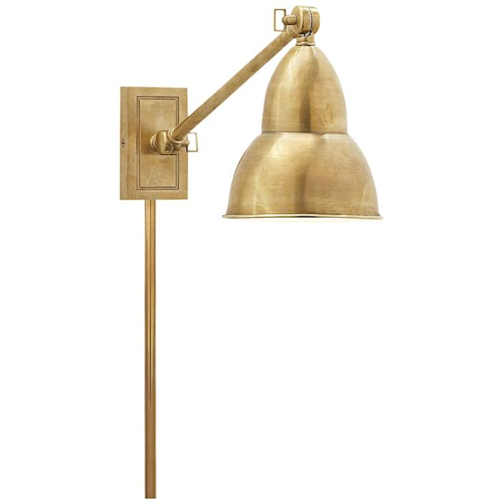 """<div class=""""caption""""> French library single-arm wall lamp by Studio VC; $335. <a href=""""https://www.circalighting.com/"""" rel=""""nofollow noopener"""" target=""""_blank"""" data-ylk=""""slk:circalighting.com"""" class=""""link rapid-noclick-resp""""><em>circalighting.com</em></a> </div> <cite class=""""credit"""">Photo: Courtesy of Circa Lighting</cite>"""