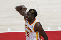 Atlanta Hawks center Clint Capela celebrates after scoring during the second half of an NBA basketball game against the Indiana Pacers on Sunday, April 18, 2021, in Atlanta. (AP Photo/Brynn Anderson)