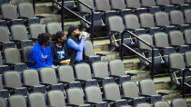 Creighton fans watch as the Bluejays warm up before taking on North Dakota State in an NCAA college basketball game in Omaha, Neb., Sunday, Nov. 29, 2020. (AP Photo/Kayla Wolf)
