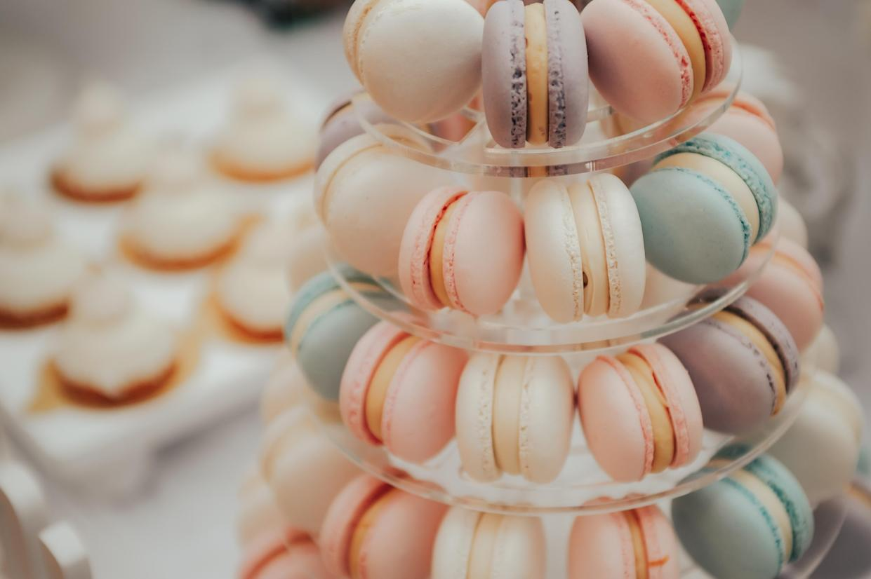 a lot of colorful macaroons at a festive banquet .