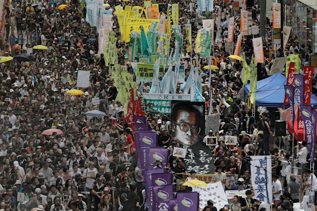 <p>Protesters carry a large image of jailed Chinese Nobel Peace laureate Liu Xiaobo as they march during the annual pro-democracy protest in Hong Kong, Saturday, July 1, 2017. (Photo: Vincent Yu/AP) </p>