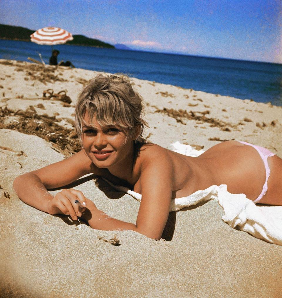 <p>Brigitte Bardot tans on the beach.</p>