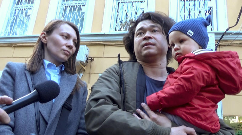 This video grab provided by TV Rain on Tuesday, Aug. 6, 2019, shows Dmitri and Olga Prokazov, parents of a 1-year-old boy speaking to journalists in Moscow, Russia . Moscow's children's rights ombudsman and other public figures have reacted with outrage to Russian prosecutors' moves to remove a 1-year-old boy from his parents because they allegedly took him to an unauthorized protest. (TV RAIN via AP)