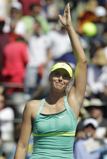 Maria Sharapova, of Russia, waves after defeating Sara Errani, of Italy, 7-5, 7-5 during the quarterfinals match at the Sony Open tennis tournament in Key Biscayne, Fla., Wednesday, March 27, 2013. (AP Photo/Luis M. Alvarez)