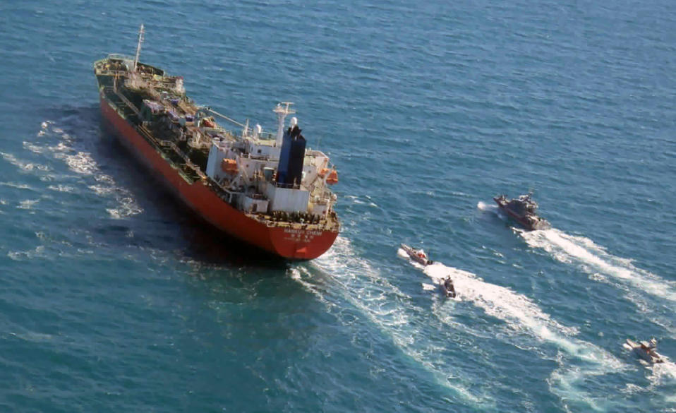 FILE - In this Jan. 4, 2021, file photo released by Tasnim News Agency, a seized South Korean-flagged tanker is escorted by Iranian Revolutionary Guard boats on the Persian Gulf. The South Korean oil tanker held for months by Iran amid a dispute over billions of dollars held in Seoul was leaving Iran early Friday, April 9, 2021. (Tasnim News Agency via AP, File)