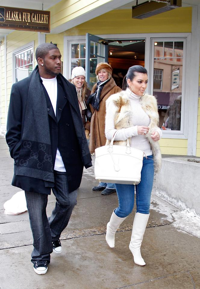 <p>The<em> Keeping Up With the Kardashians</em> star and her boyfriend at the time, New Orleans Saints running back Reggie Bush, hit Main Street. Kim had to be freezing… (Photo: Frazer Harrison/Getty Images) </p>