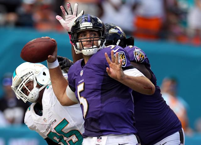 MIAMI GARDENS, FL - OCTOBER 06: Quarterback Joe Flacco #5 of the Baltimore Ravens throws against the Miami Dolphins at Sun Life Stadium on October 6, 2013 in Miami Gardens, Florida. The Ravens defeated the Dolphins 26-23. (Photo by Marc Serota/Getty Images)