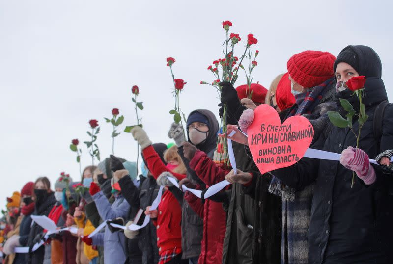 Participants form a human chain during a demonstration to support female political prisoners and to protest against police violence in Saint Petersburg