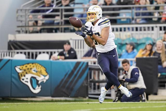 """Tight end Hunter Henry, who the Chargers protected with a franchise tag, catches a pass for a touchdown during the second quarter of a game against the Jacksonville Jaguars last season. <span class=""""copyright"""">(James Gilbert / Getty Images)</span>"""