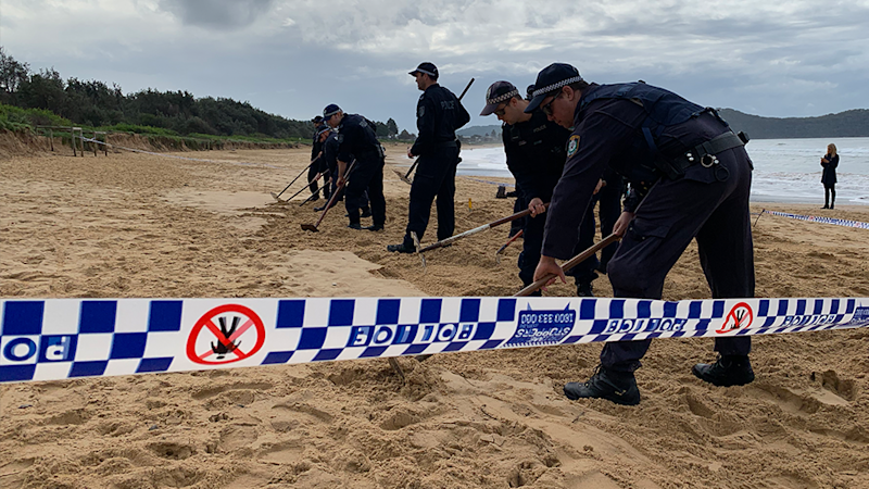 Police comb Umina Beach after the discovery of a what is believed to be a human jaw bone. Source: Yahoo News Australia / Michael Dahlstrom