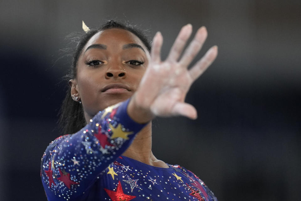Simone Biles, of the United States, performs her floor exercise routine during the women's artistic gymnastic qualifications at the 2020 Summer Olympics, Sunday, July 25, 2021, in Tokyo. (AP Photo/Natacha Pisarenko)