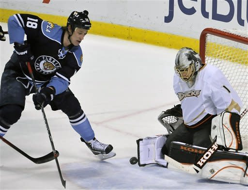 Anaheim Ducks goalie Jonas Hiller (1) makes a save on-goal from Florida Panthers' Shawn Matthias (18) during the second period of an NHL hockey game on Sunday, Feb. 19, 2012, in Sunrise, Fla. (AP Photo/Gary I Rothstein)