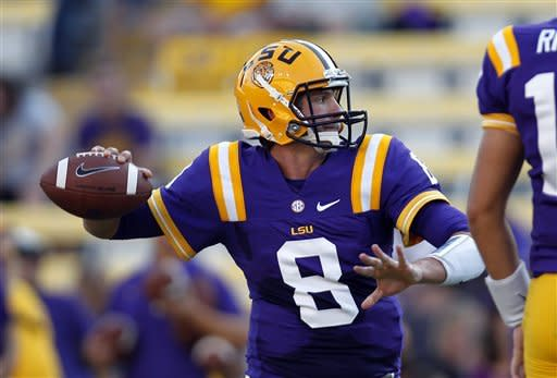 LSU quarterback Zach Mettenberger (8) warms up before their NCAA college football game against Idaho in Baton Rouge, Saturday, Sept. 15, 2012. (AP Photo/Gerald Herbert)