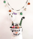 """<p>Did a witch take a dive into this spooky basket? From the pop-pom hat and the one leg sticking out, it looks like the answer is yes! It gives off real <em>Wizard of Oz </em>vibes.</p><p><a href=""""https://www.instagram.com/p/CFsyJvZgBNX/"""" rel=""""nofollow noopener"""" target=""""_blank"""" data-ylk=""""slk:See more @beingbullard »"""" class=""""link rapid-noclick-resp""""><em>See more @beingbullard »</em></a><br></p>"""