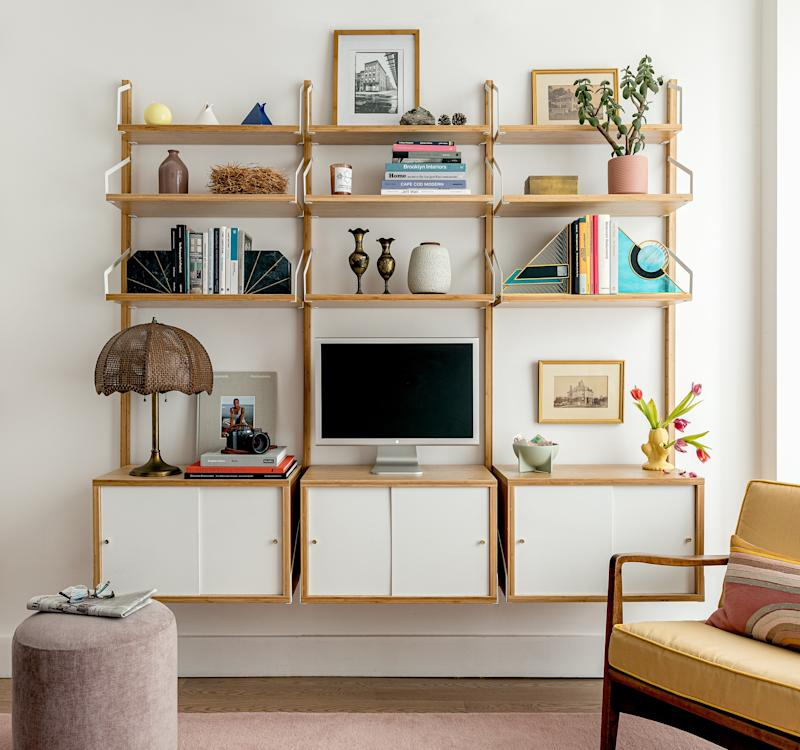 The IKEA shelving unit was left over from Sean's previous work studio. It does double duty in the living room, offering closed storage for his work stuff like negatives and gear, while providing open shelving for displaying books, artwork, and miscellany of the living space variety.