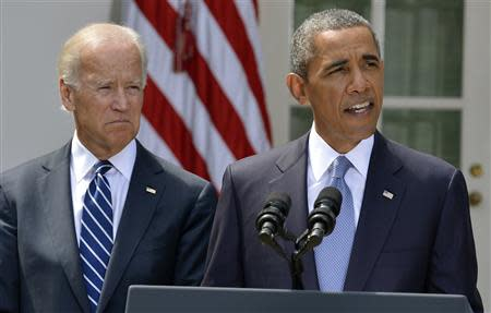 U.S. President Barack Obama speaks about Syria next to Vice President Joe Biden (L) at the Rose Garden of the White House August 31, 2013, in Washington. REUTERS/Mike Theiler