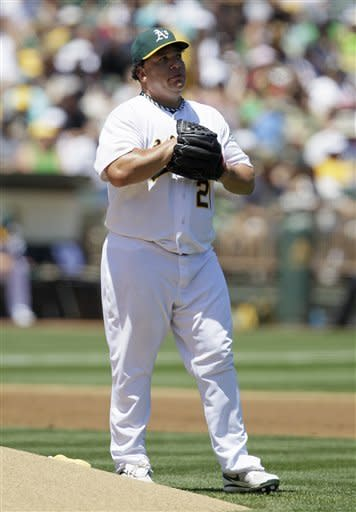 Oakland Athletics starting pitcher Bartolo Colon stands on the mound after loading the bases in the third inning of their baseball game against the New York Yankees Sunday, July 22, 2012 in Oakland, Calif. (AP Photo/Eric Risberg)