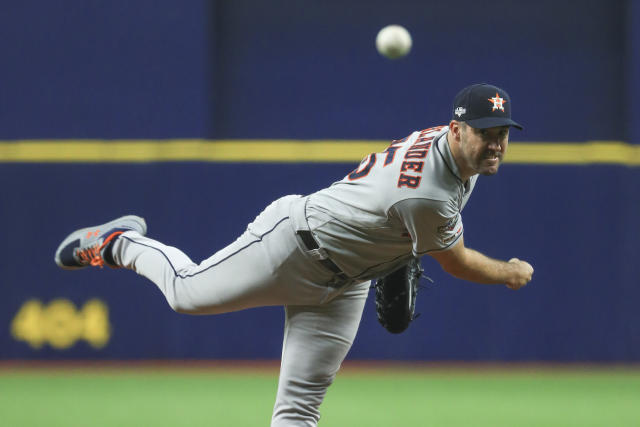 Houston Astros' Justin Verlander pitches to a Tampa Bay Rays batter during the first inning of Game 4 of a baseball American League Division Series, Tuesday, Oct. 8, 2019, in St. Petersburg, Fla. (AP Photo/Mike Erhmann, Pool)