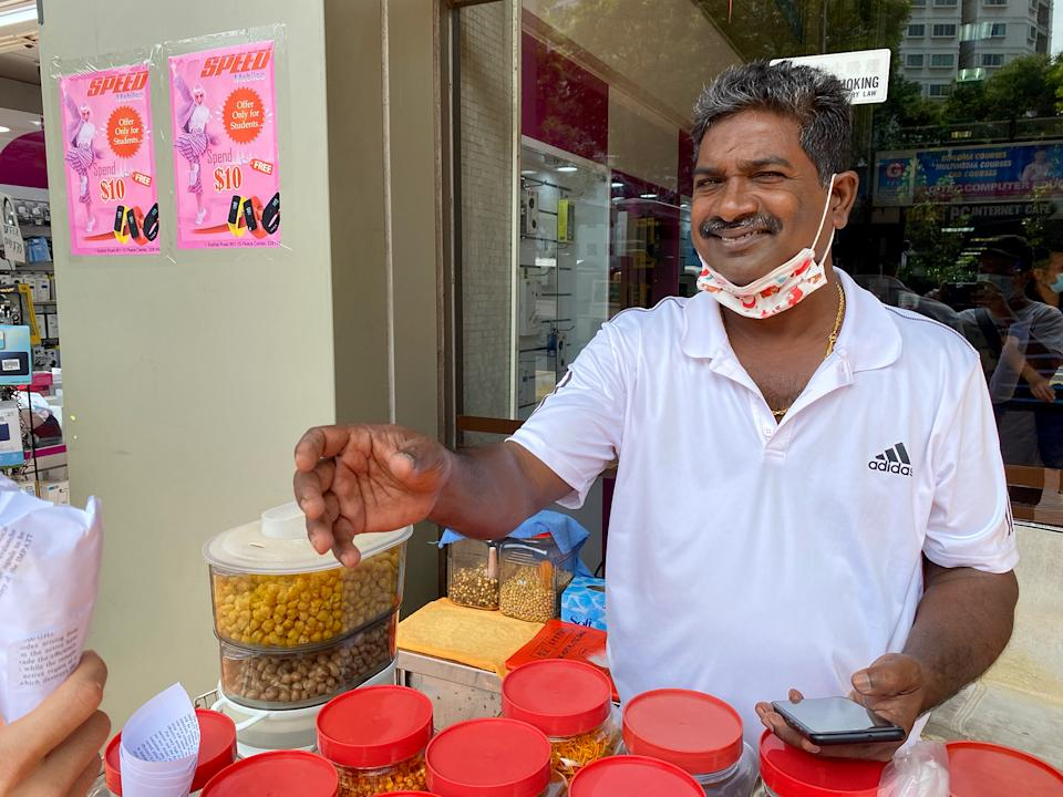 Amirthaalangaram Moorthy, 53, is now Singapore's last kacang puteh man. (PHOTO: Dhany Osman/Yahoo News Singapore)