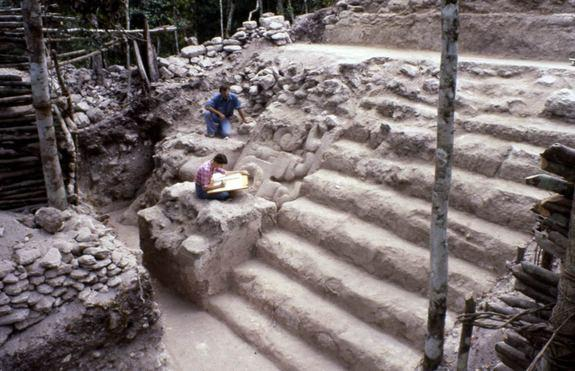 North face of the Jaguar Paw Temple, in the Tigre Complex at El Mirador, Guatemala, showing the east mask, stairway, and upper landing during excavations by Project El Mirador. Most of the Preclassic turkey bones were associated with this build
